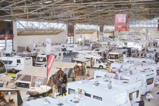 Exhibition hall dislaying mobile homes, camping busses and caravans