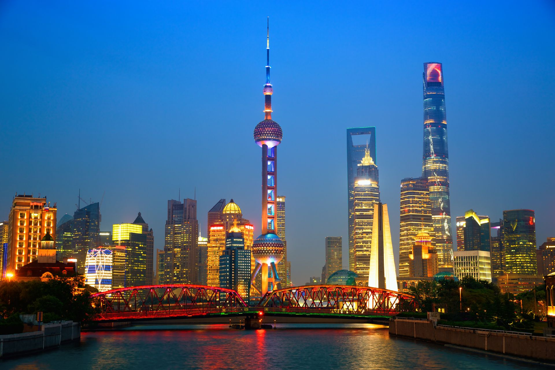 Shanghai skyline at dusk with illuminated Waibaidu bridge